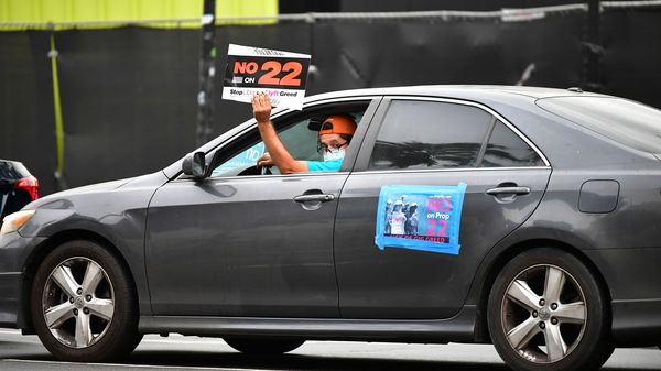 A California ballot measure over whether Uber and Lyft should treat their drivers as employees divided gig workers but was approved by voters.